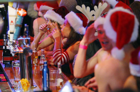 Participants in the 10th annual Santa Speedo Run drink at the Lir Bar before the event in Boston, Massachusetts December 12, 2009. Proceeds from the 1.25 mile through Boston's Back Bay run will benefit local charities.